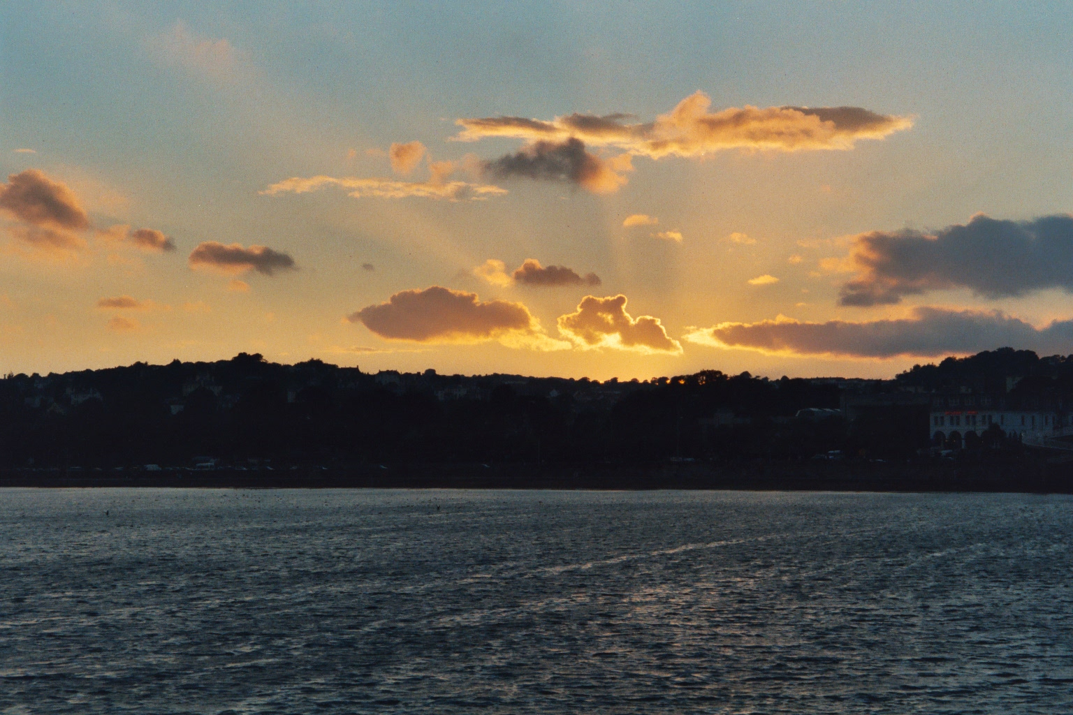 sunset over Torquay from The English Channel